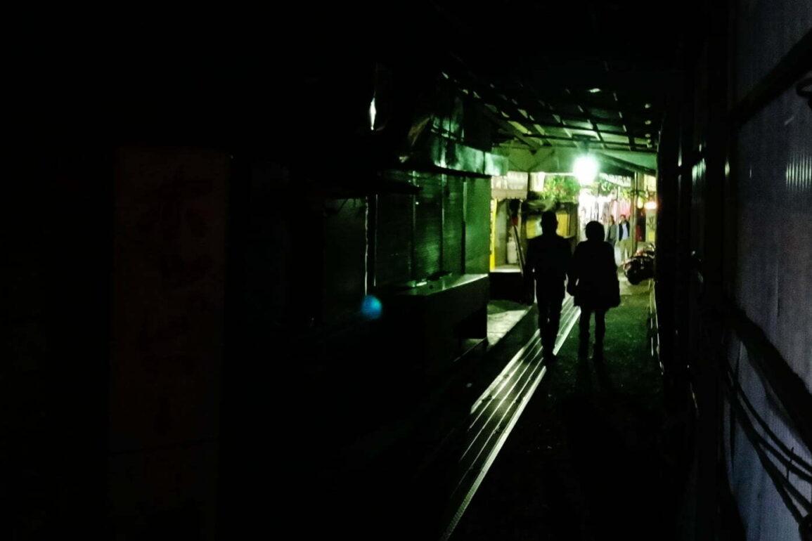 9 couple walking in dark tunnel